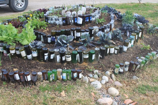 Best 20 Herb Garden Design 2017: Herb Spiral: Made With Bottles